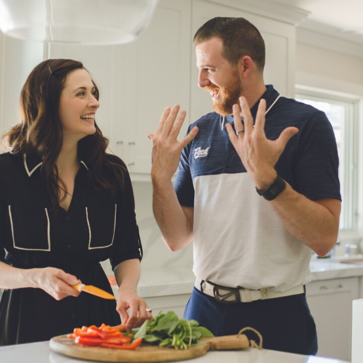 Boost your mood with food! Stephen and Elise Compston laugh together while preparing a meal