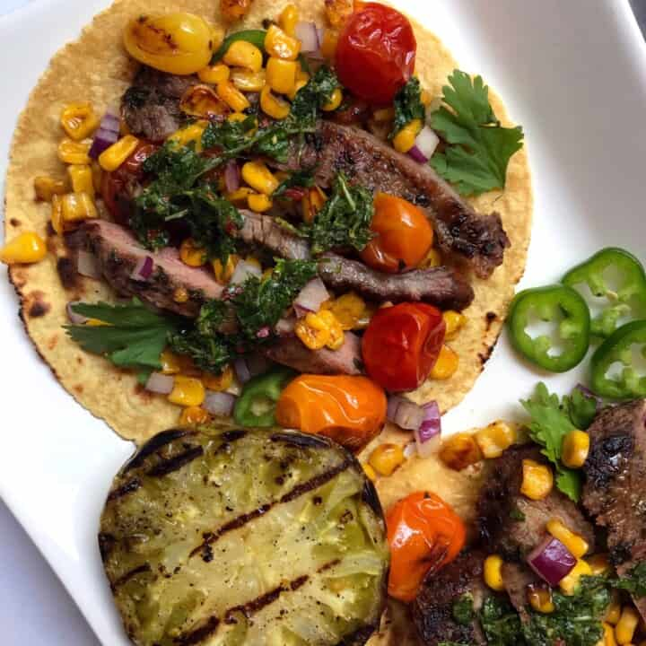 Overhead shot of Grilled Flank Steak Tacos with Cilantro Chimichurri