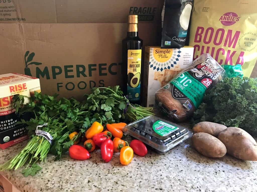 Delivery box from Imperfect Foods with fruits, veggies, and pantry items
