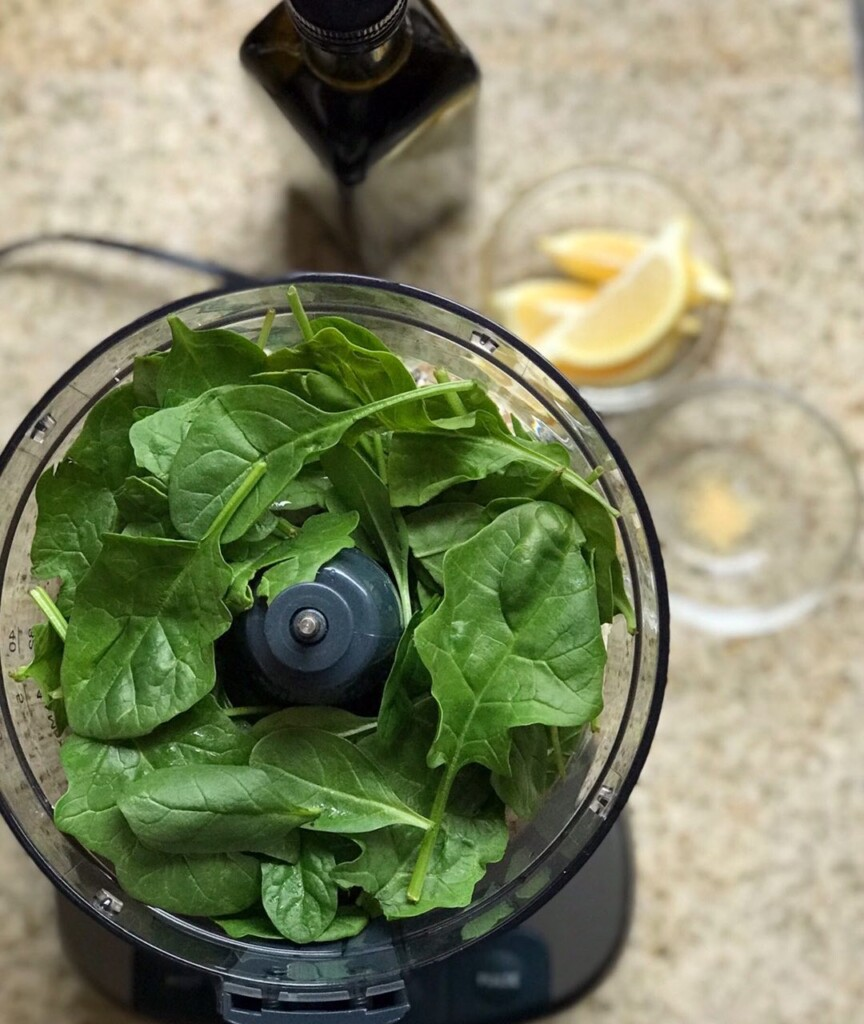Overhead shot of spinach in a food processor