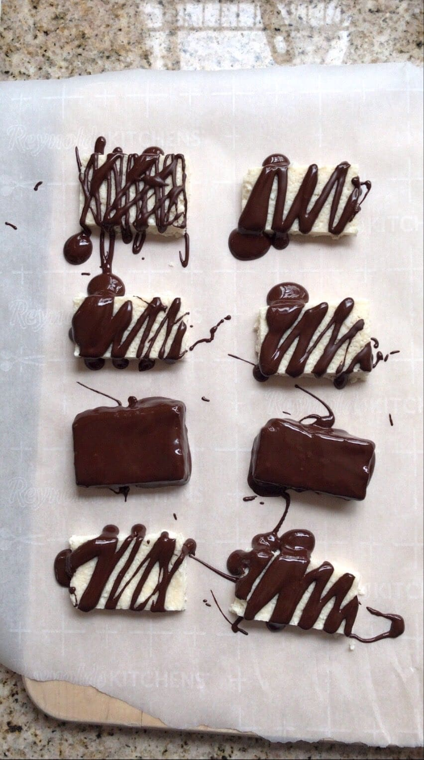 Overhead shot of Mounds Bars with fresh Chocolate Drizzle