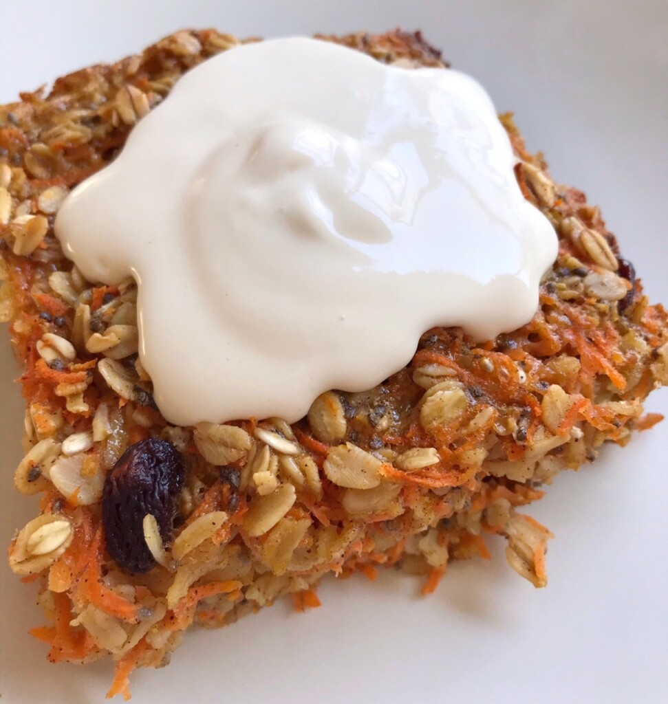 Close-up shot of slice of Carrot Cake Baked Oatmeal with cream cheese frosting