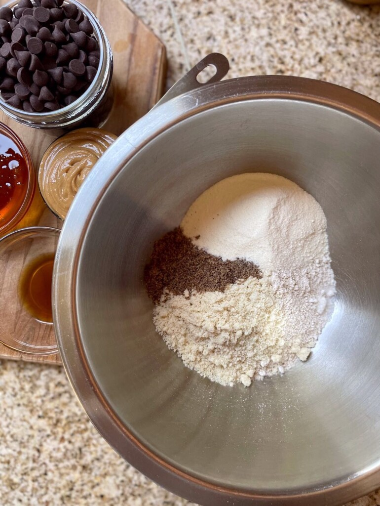 Overhead shot of dry perfect bar ingredients in a bowl