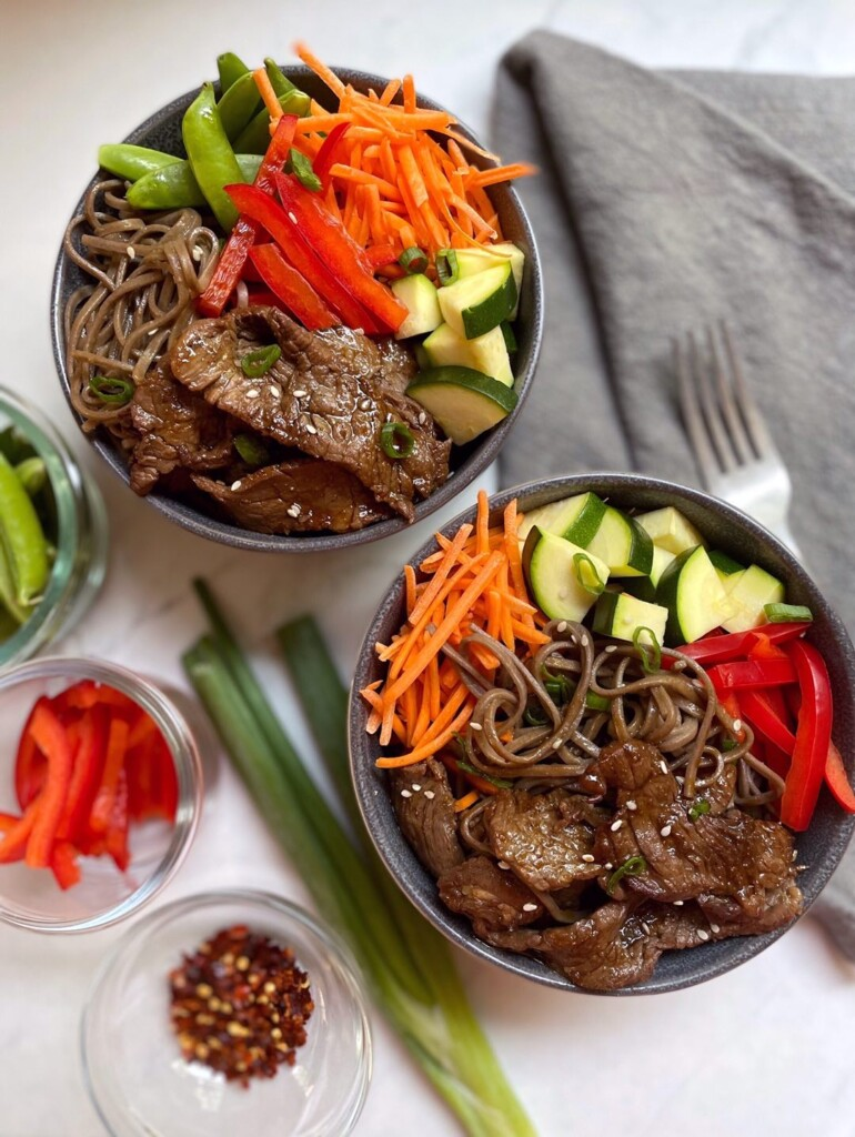 Overhead shot of filled beef noodle bowls