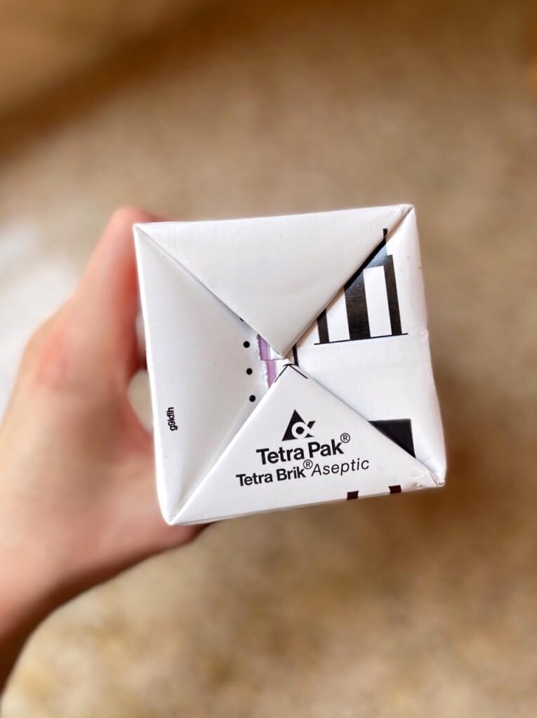 Closeup shot of Tetra Pak logo on the bottom of a carton